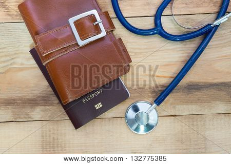 Medical tourism concept. Stethoscope with passport .