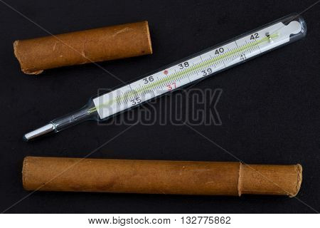 Medical mercury thermometer on the black background