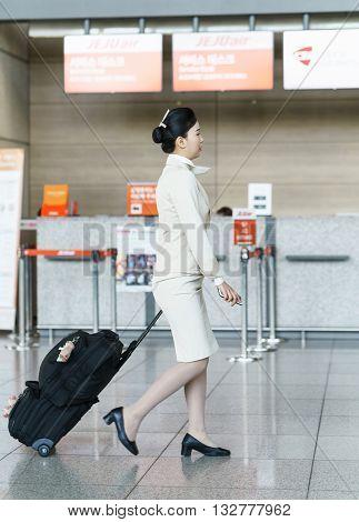 Asian Korean Air Flight Stewardess On The Incheon International Airport