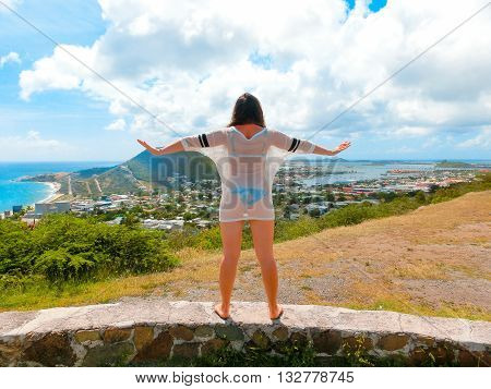 The back view of girl at Sint Maarten island Caribbean sea