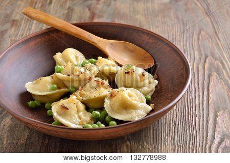 Ravioli with ricotta and peas tortellini, selective focus