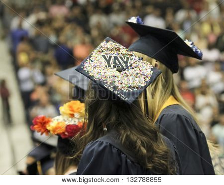 FLAGSTAFF, ARIZONA, MAY 13. Northern Arizona University on May 13, 2016, in Flagstaff, Arizona. A pair of young women at their Northern Arizona University Commencement 2016.