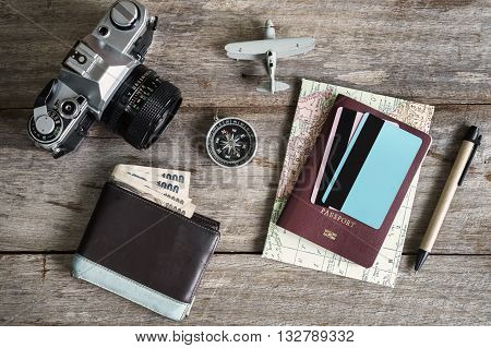 Outfit of traveler on wooden background and copy space Travel concept