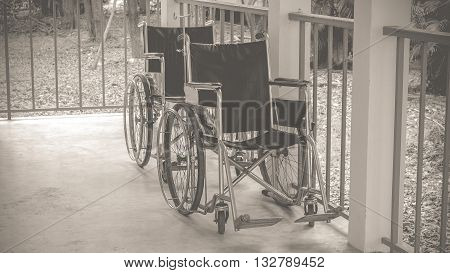 Wheelchair empty wait to use at hospital hallway process in vintage black and white style.