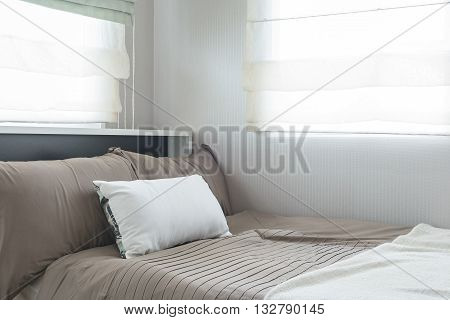 Single Bed With Set Of Pillows In Modern Bedroom
