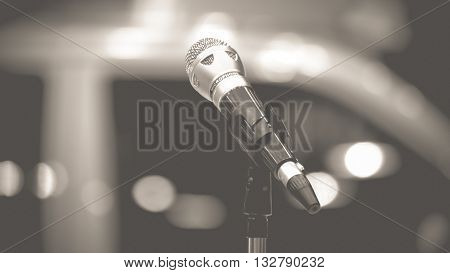 Microphone in seminar event defocus on background process in vintage black and white style.