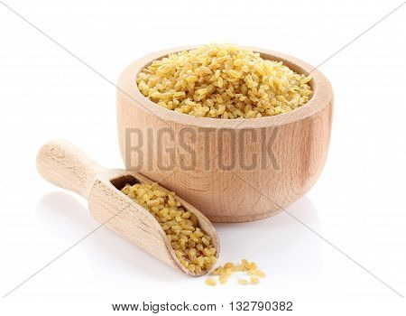 Bulgur in wooden bowl isolated on white background