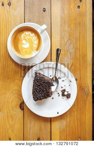 picture cup of coffee and chocolate cake on a wooden table