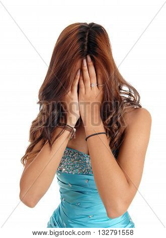 A young woman in a blue evening dress covering her face she is ashamed in closeup isolated for white background.