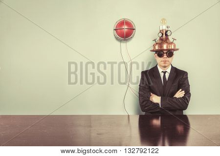 Vintage businessman sitting at office desk with alert light
