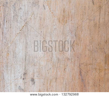 Weathered dirty wood panel with scratched smudged marks