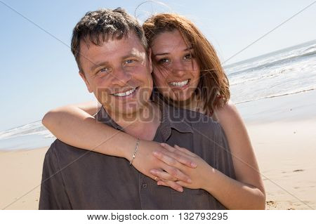 Couple In Love On The Beach Holding Each Other
