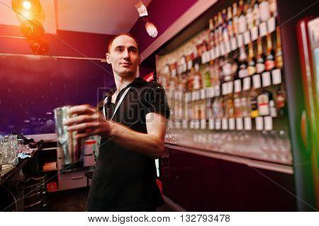 Young Barman Throws Ice At The Bar