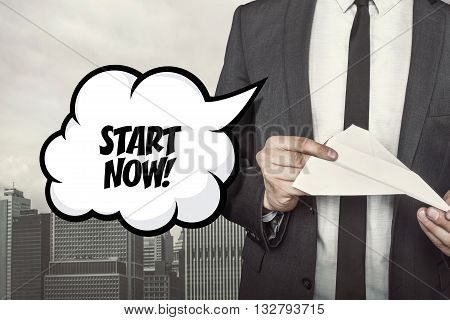 Text on speech bubble with businessman holding paper plane in hand on city background