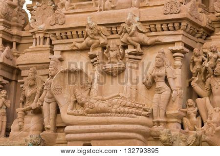 Chettinad India - October 16 2013: Detail of Shiva temple in Thirumayam. Lord Vishnu lies down on the coil of a five headed snake. Image is called Ananta Shesha or Ranganatha.
