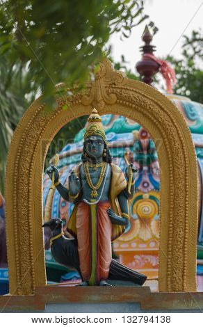 Chettinad India - October 17 2013: Statue of Shani known as Satan in the West at his shrine in Kadiapatti. His mount the black bird in photo.