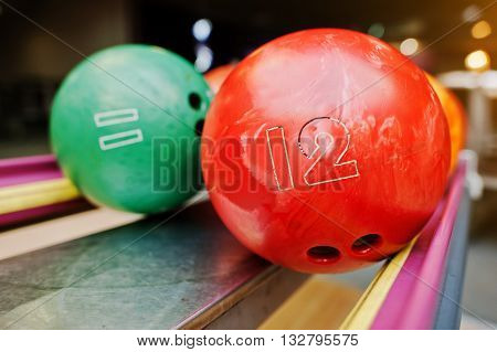 Two Colored Bowling Balls Of Number 12 And 11