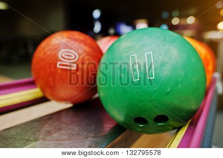 Two Colored Bowling Balls Of Number 11 And 10