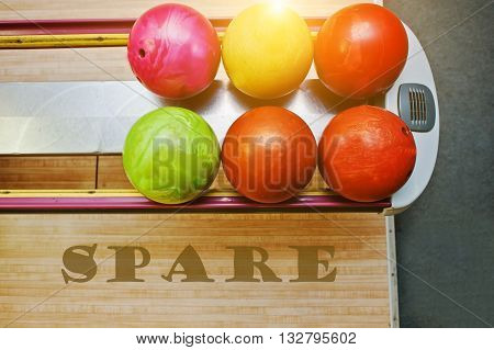 The word spare background bowling balls at alley