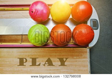 The word play background bowling balls at alley