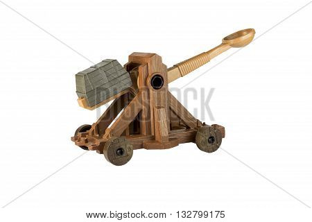 An ancient Norman Catapult isolated on a white background.
