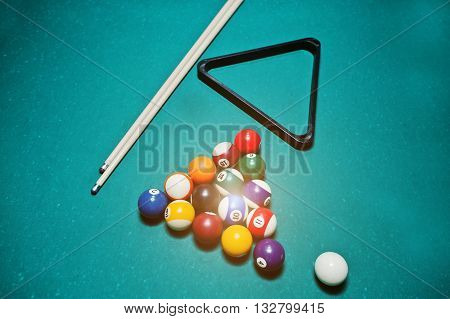 Billiard Balls In A Pool Table At Triangle With Billiard Cue