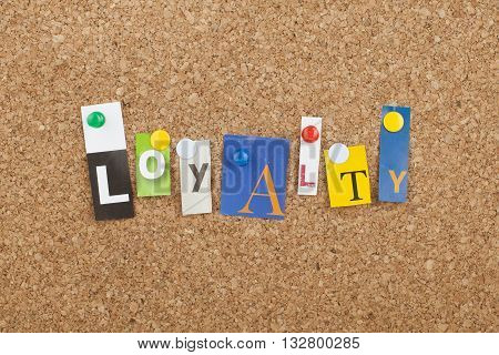 Loyalty word as letters pinned on cork board