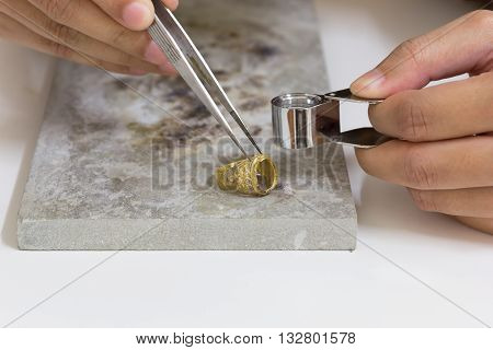 Gold ring hand craft on stone gold ring gold bar gold goldsmith.