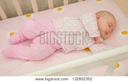 Very nice sweet baby sleeping in crib