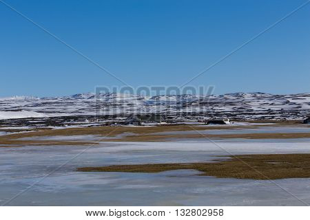 Winter natural landscape with mountain background and clear blue sky, Iceland