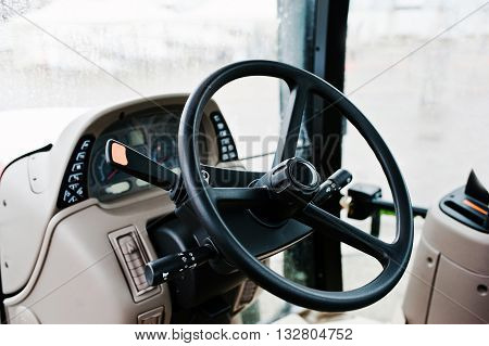 Steering Wheel And The Controls In The Cabin Of The New Tractor