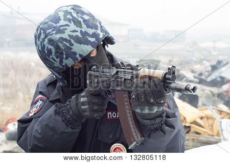 Norilsk, Russia - September, 24: А policeman holds a gun in his hand.