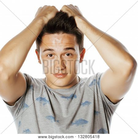 Young attractive handsome man holding hands on his head emotional wondering isolated on white background