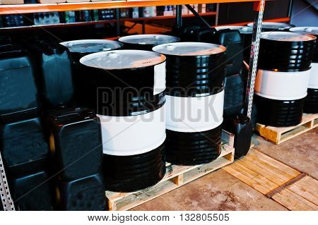 Barrels And Cans Of Motor Oil On Shelves