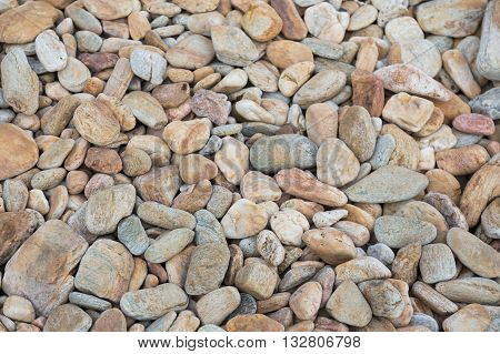 Round stone on natural beach background and texture