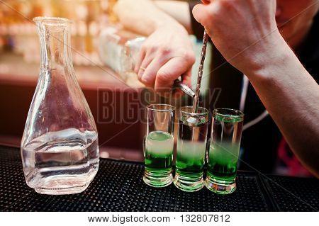 Close Up Barman Hands  Preparing Green Mexican Cocktail Drink At The Bar