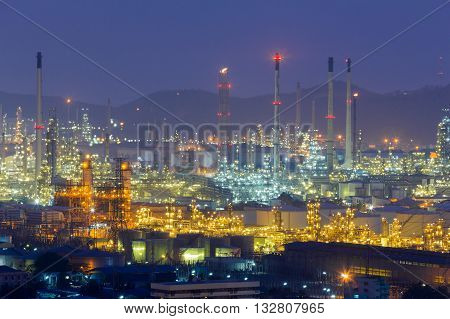 Aerial view, Oil refinery lights at twilight,mountain background