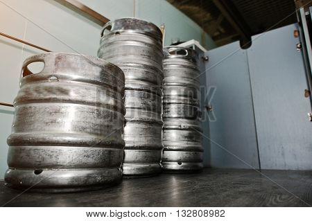 Three metal beer keg barrel at pub
