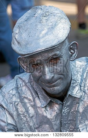 SZEGED HUNGARY - MAY 22 2016: Portrait of a man painted in silver to portray a statue on the street.
