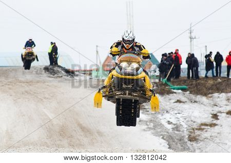 Tyumen, Russia - March 08. 2008: IV stage of personal-team Championship of Ural Federal district in over-snow cross-country. Jump of sportsman on snowmobile