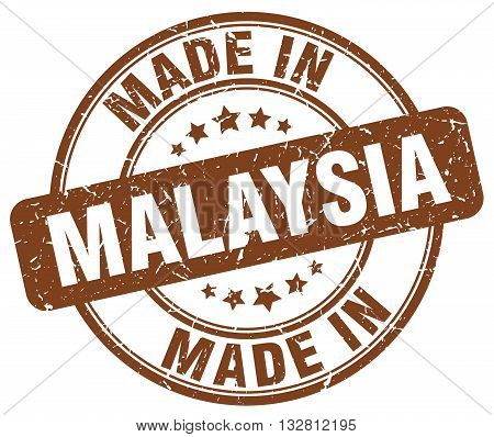 made in Malaysia brown round vintage stamp.Malaysia stamp.Malaysia seal.Malaysia tag.Malaysia.Malaysia sign.Malaysia.Malaysia label.stamp.made.in.made in.
