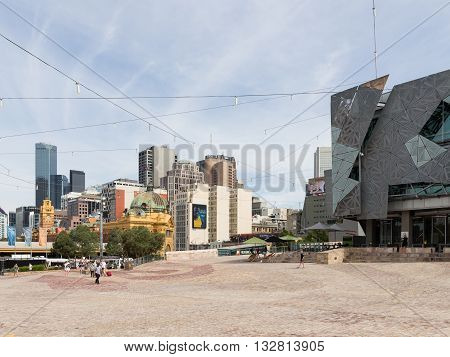 Melbourne - February 23 2016: People and tourists at Federation Square on a hot day near the station Flinders Street Station February 23 2016 Melbourne Australia