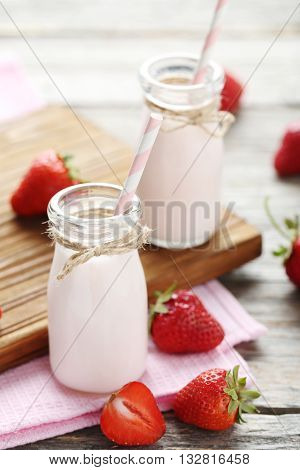 Strawberry Yogurt In Bottle On Wooden Table