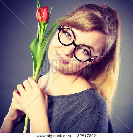 Nerdy Girl Sniffing Flower.