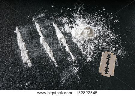 Cocaine White Powder In Lines And Razor. Narcotics Concept.