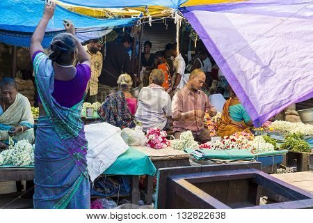 Pondicherry, India, February 21, 2014. Sales of fruits vegetables and flowers in the main market, daily market.