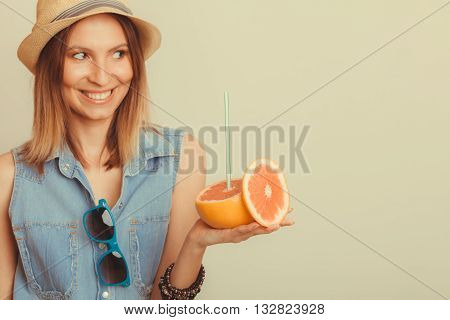 Happy glad woman tourist in straw hat with sunglasses and grapefruit citrus fruit. Healthy diet food. Summer vacation holidays concept. Instagram filtered.