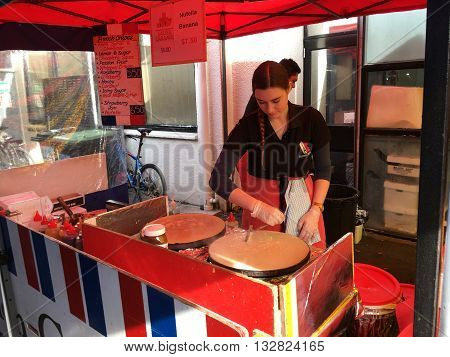AUCKLANDJUNE 4: Cook prepare French crepe a thin pancake usually made from wheat flour at the La Cigale French Market in Auckland New Zealand on June 4 2016.