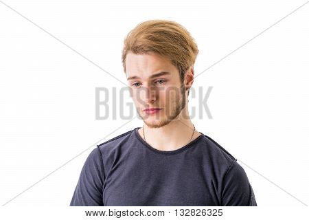 Sad or worried handsome young man looking down, isolated on white