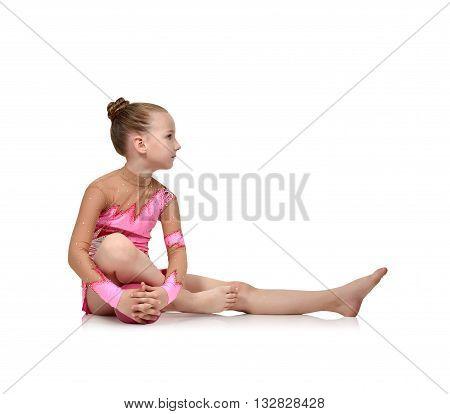 Girl Gymnast Sitting With Ball